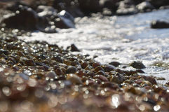 Water splash on small pebbles Stock Image