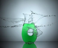 Water splash on soda. Water splashing on a mug of soda Royalty Free Stock Images