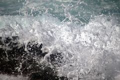 Water Sea Splashing over wall barrier. A still image of a splash of sea water over wall barrier stock photo