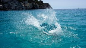 Water splash. In a turquoise water of a beach Royalty Free Stock Images