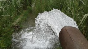 Water splash from tuwell pipe in India agricultural style photo stock images