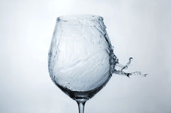 Water splash on a wineglass Royalty Free Stock Photo