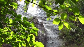 Waterfall in the forest Ciamis West Java. The water splashed on the stone wall behind the leaves, the location is located in the hegarmanah village of ciamis royalty free stock photos