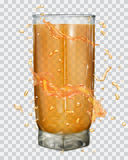 Water splashes in orange colors around a glass with orange juice Stock Image