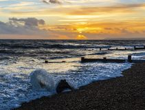 Sunset on a rising tide at bexhill in East Sussex, England stock photo