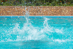 Water splashes in the swimming pool. Close view of the water splashes in the swimming pool Royalty Free Stock Photography