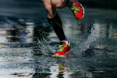 Water splashes from under its running shoes Stock Image
