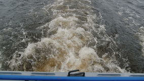 Water splashes from underneath a motor. Sprays of water in a lake, river, sea, ocean. stock video