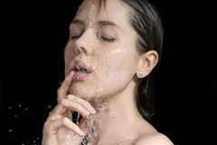 Water splashes on woman`s face Stock Image