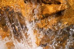 Water splashing. A background of water splashing over rocks Stock Photos