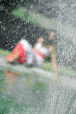 Water splashing against the girl. Water splashing against the beautiful girl Royalty Free Stock Image