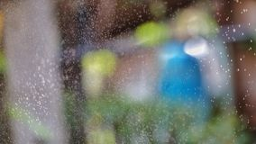 Blurred many small spraying droplets in the air in outdoor space for background backdrop royalty free stock images