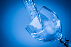 Water splashing in a blue glass Royalty Free Stock Image