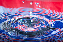 Water splashing droplets. With water ripples royalty free stock photo