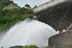 Water splashing from floodgate Khun Dan Prakarn Chon huge concrete dam in Thailand. Water splashing from floodgate Khun Dan Prakarn Chon the huge concrete dam in stock image