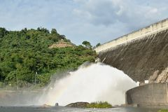 Water splashing from floodgate Khun Dan Prakarn Chon huge concrete dam in Thailand. Water splashing from floodgate Khun Dan Prakarn Chon the huge concrete dam in royalty free stock image