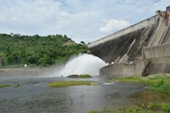 Water splashing from floodgate Khun Dan Prakarn Chon huge concrete dam in Thailand. On sunny day royalty free stock image