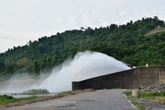 Water splashing from floodgate Khun Dan Prakarn Chon huge concrete dam in Thailand. Water splashing from floodgate Khun Dan Prakarn Chon the huge concrete dam in royalty free stock photos
