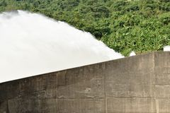 Water splashing from floodgate Khun Dan Prakarn Chon huge concrete dam in Thailand. On sunny day royalty free stock photos