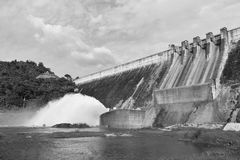 Water splashing from floodgate Khun Dan Prakarn Chon huge concrete dam in Thailand. On sunny day royalty free stock photography