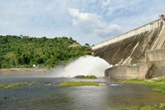 Water splashing from floodgate Khun Dan Prakarn Chon huge concrete dam in Thailand. Water splashing from floodgate Khun Dan Prakarn Chon the huge concrete dam in stock photo
