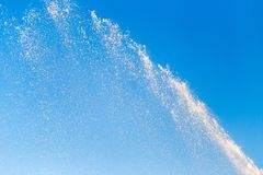 Water splashing from the fountain in the background of blue sky Royalty Free Stock Photography