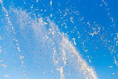 Water splashing from the fountain in the background of blue sky.  stock image