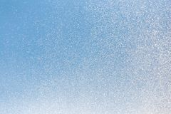 Water splashing from the fountain in the background of blue sky.  royalty free stock images