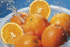 Water splashing on fresh oranges in strainer Stock Photography