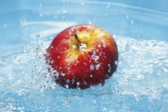 Water splashing on fresh red apple Royalty Free Stock Images