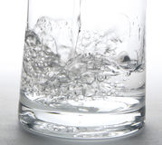Water Splashing into a glass Royalty Free Stock Image