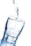Water splashing into glass isolated Stock Photo