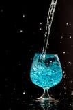 Water splashing in a glass Stock Photo