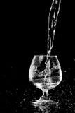 Water splashing in a glass Royalty Free Stock Photos