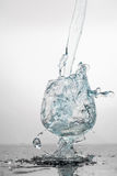Water splashing in a glass Stock Photography
