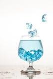 Water splashing in a glass Stock Image
