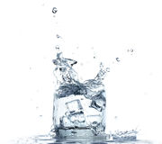 Water splashing from glass on white background Stock Images