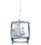 Water splashing from glass  on white Royalty Free Stock Photo