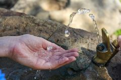 Water splashing into hand Stock Photography