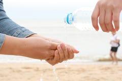 Water splashing on hands Stock Photos