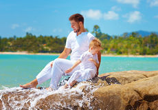 Water splashing on happy father and son on vacation Royalty Free Stock Photography