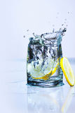 Water splashing from lemon Stock Photo
