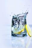 Water splashing from lemon Stock Photo