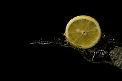 Water splashing with lemon. Royalty Free Stock Image