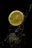 Water splashing with lemon. Stock Image