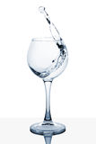 Water splashing out of a tall glass. Water splashing out of a tall wine glass royalty free stock image