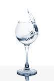 Water splashing out of a tall glass. Water splashing out of a tall wine glass stock photography