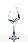 Water splashing out of a tall glass. Water splashing out of a tall wine glass stock images