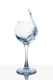 Water splashing out of a tall glass. Water splashing out of a tall wine glass royalty free stock images