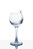 Water splashing out of a tall glass. Water splashing out of a tall wine glass royalty free stock photo